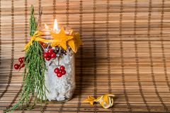 Christmas hand made candle craft on the eastern style wooden tablecloth Royalty Free Stock Photography