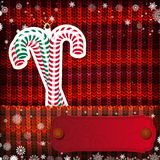 Christmas decorations on handmade knitted background Stock Photo