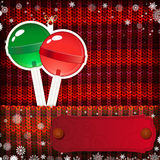 Christmas decorations on handmade knitted background.  royalty free illustration