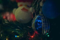 Holiday decorations hang on a Christmas tree and create a mood royalty free stock images
