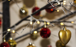 Christmas decorations hanging from contemporary christmas tree Stock Photo