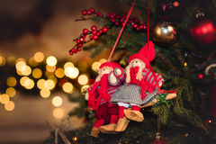 Christmas decorations hanging on fir tree Royalty Free Stock Photo