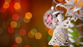 Christmas decorations hanging in front of colorful blinking lights stock footage