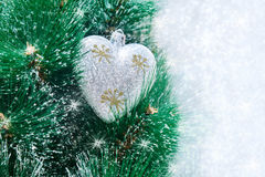 Christmas decorations hanging on a pine tree with glitter, Stock Images