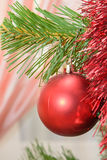 Christmas decorations hanging on a pine tree with glitter, Royalty Free Stock Photo