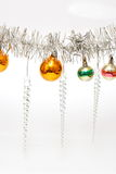 Christmas decorations hanging on white Royalty Free Stock Image
