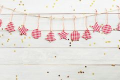Christmas decorations hanging on wooden background with falling golden star Royalty Free Stock Photo