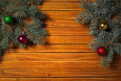Christmas decorations. Holiday background with fir branches. Toy balls. Top view royalty free stock images