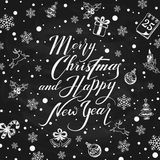 Christmas decorations with holiday lettering on black chalkboard Royalty Free Stock Image