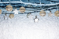 Christmas decorations and holiday lights hanging on bare branche Royalty Free Stock Images
