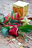 Christmas decorations and holly branches Stock Photography