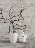 Christmas decorations home interior - dry branches in a white vase and a ceramic Santa Claus on a white  wooden table Royalty Free Stock Photo