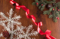 Christmas decorations. Hristmas decoration with red ribbon on a wooden board stock image