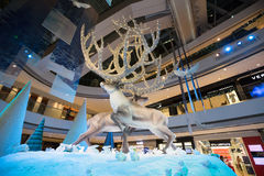 Christmas decorations in ifc mall, Hong Kong. A pair of majestic stags with far reaching 9m tall antlers each form a spectacular Reindeer Tree in the Oval Atrium Stock Image