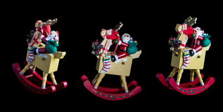 Christmas decorations: 3 Isolated Rocking Santas on Thier Reinde Stock Photography