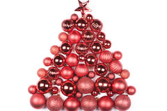 Christmas decorations isolated on white. Christmas decorations arranged in tree shape Royalty Free Stock Photos