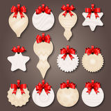 Christmas Decorations Labels With Bows. Christmas decorations paper labels of various shape with pale patterns and red bows isolated vector illustration stock illustration