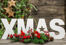 Christmas decorations and letter XMAS with pine tree branches Stock Photo
