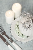 Christmas decorations and a little meringue with white candle Royalty Free Stock Photos