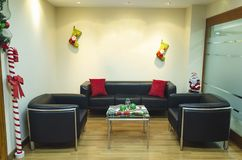 Christmas decorations in living room in the office stock photography