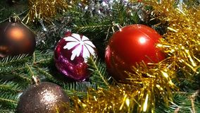 Christmas decorations lying among the branches stock video footage