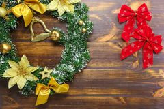 Christmas decorations lying on wooden board flat lay background stock photo