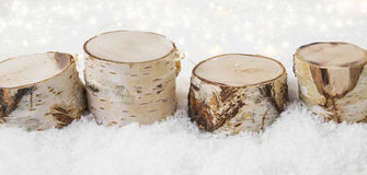Christmas decorations made of birch wood in the snow with backgr Royalty Free Stock Image