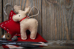 Christmas decorations made of felt and tools to create them Stock Photos