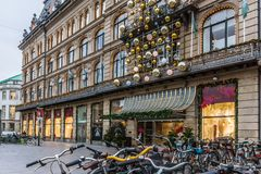 Christmas decorations at Magasin du Nord in Copenhagen. Christmas decorations and bikes at Magasin du Nord in Copenhagen, November 9, 2017 Royalty Free Stock Photos