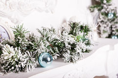 Christmas decorations on the mantelpiece. And fur-tree branch Stock Images