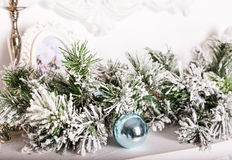 Christmas decorations on the mantelpiece. And fur-tree branch Stock Image