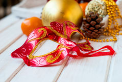 Christmas decorations, mask, bumps on the wooden table Stock Image