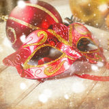 Christmas decorations, mask, bumps on the wooden table Stock Photo