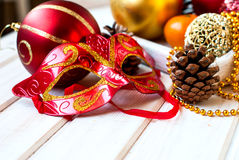 Christmas decorations, mask, bumps on the wooden table Royalty Free Stock Photography
