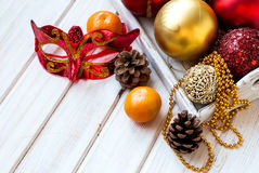 Christmas decorations, mask, bumps on the wooden table Royalty Free Stock Photos