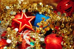 Christmas decorations mixed in storage box. Closeup view Stock Image