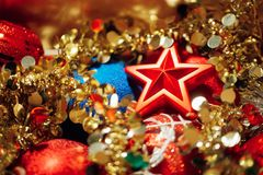 Christmas decorations mixed in storage box. Closeup view Stock Images