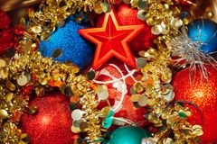 Christmas decorations mixed in storage box. Closeup view Stock Photos