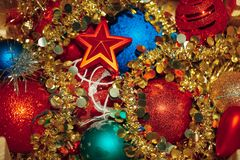 Christmas decorations mixed in storage box Royalty Free Stock Image