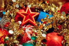 Christmas decorations mixed in storage box Stock Images