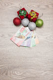 Christmas decorations and money Royalty Free Stock Photography