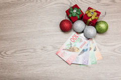 Christmas decorations and money Stock Photos