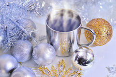 Christmas decorations with a mug of hot coffee. Christmas decoration with balls, tree and a cup of hot coffee Stock Image