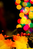 Christmas Decorations and Multicolored Blurred Lights Royalty Free Stock Images