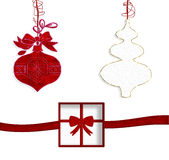 Christmas decorations. Decorations of native red  and white with package gift Royalty Free Stock Images
