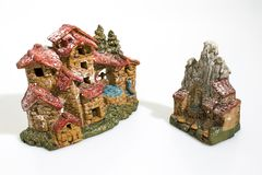 Christmas decorations, nativity scene houses isolated in a white royalty free stock images