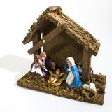 Christmas decorations, nativity scene houses in a white royalty free stock photos