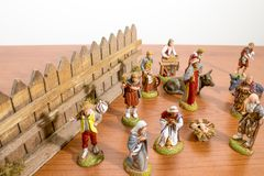 Christmas decorations, nativity scene statues on a wood table royalty free stock image