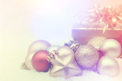 Christmas decorations nestled in snow Royalty Free Stock Image