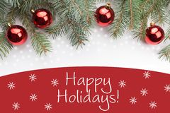 Christmas decorations with the New Year greeting `Happy Holidays!` Royalty Free Stock Photo